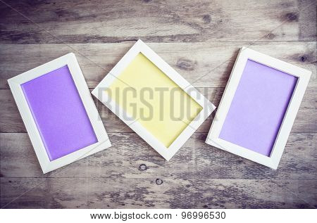 Three Wooden Photo Frame On Old Wooden Wall.