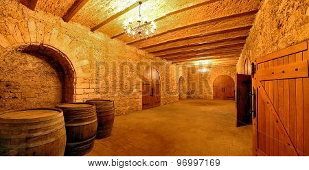 The interior of the basement of the old cellar of the winery. Barrels of wine in the basement corridor..3