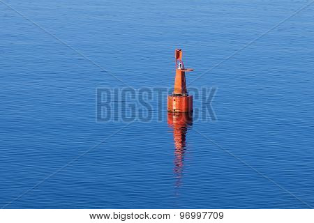 Red Modern Navigation Buoy On Still Water