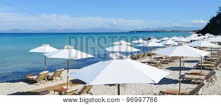 Beautiful Long White Sand Beach Beside The Turquoise Sea And Transparent Mediterranean Lined With Su