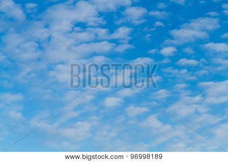 Blue sky and white puffy clouds