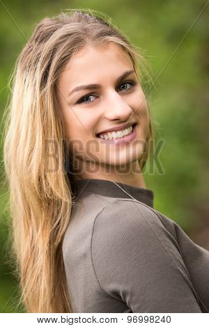 Portrait of a beautiful smiling teenage girl