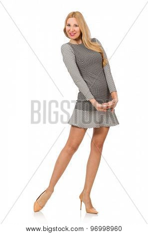 Blond girl in polka dot dress isolated on white
