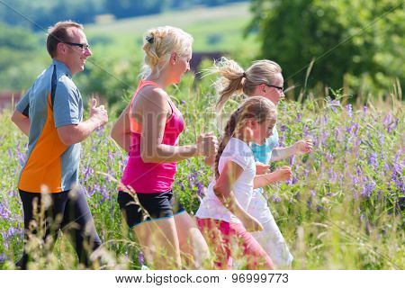 Family running for better fitness in summer through beautiful landscape