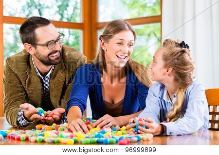 Family spending quality time playing together with toys