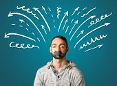 stock photo of taboo  - Young man with taped mouth and white drawn lines and arrows around his head   - JPG
