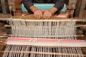 foto of handloom  - details of old woman handle handloom weaving - JPG