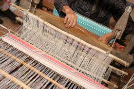 pic of handloom  - details of old woman handle handloom weaving - JPG