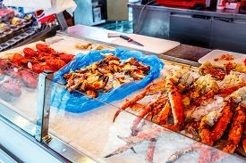image of norway lobster  - Various seafood on the shelves of the fish market in Norway - JPG