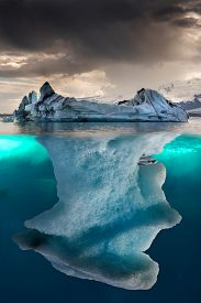 picture of iceberg  - Big iceberg undewater with a small part floating - JPG