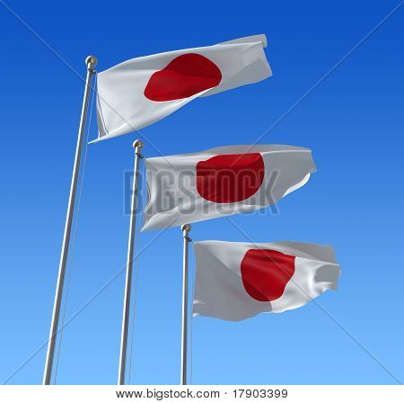 Flag of Japan against blue sky.