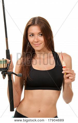 Woman Holding A Fishing Rod With Float