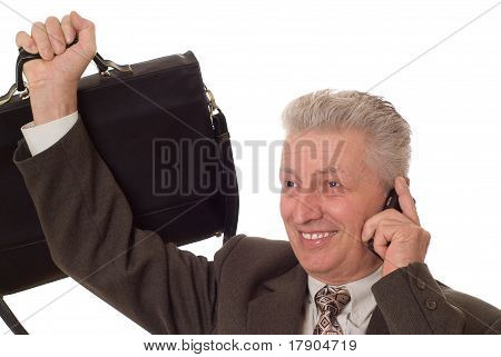 Closeup Portrait Of An Older Man Talking On A Mobile Phone Against White Background