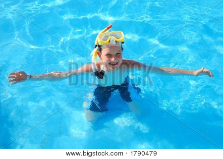 Happy Snorkling Boy In Pool