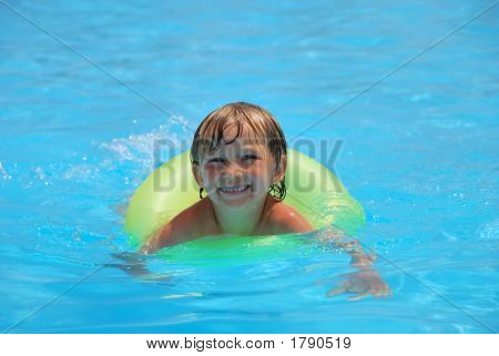Boy Playing In Pool Innertube