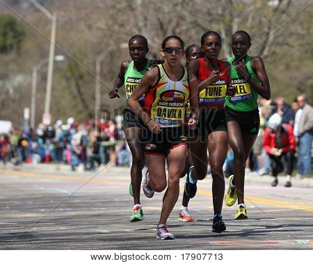 BOSTON - APRIL 18: Elite Women runners races up the Heartbreak Hill during the Boston Marathon April