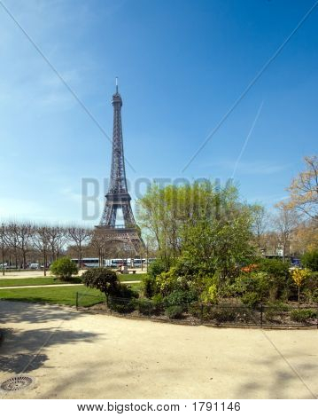 Eiffel Tower In Springtime With A Blue Sky Background