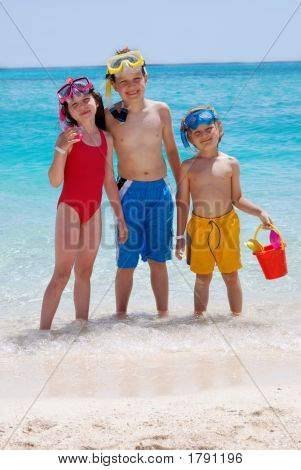 Three Children Wading In Ocean