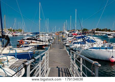 pier with many moored boats in the port in sozopol, bulgaria