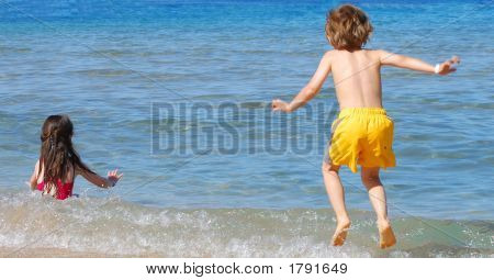 Happy Kids In Sea