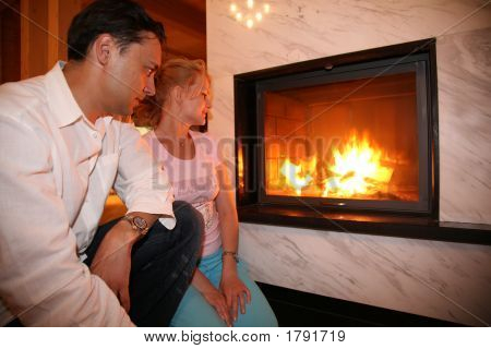 Man Woman And Fireplace