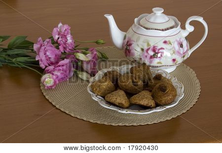 Still life with Peanut cookies Teapot and flowers