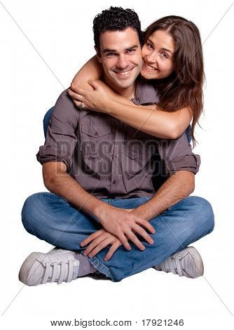Young couple cuddling happily in love
