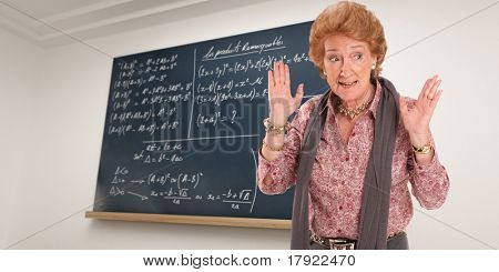 Math teacher with an impatient gesture with a blackboard as background