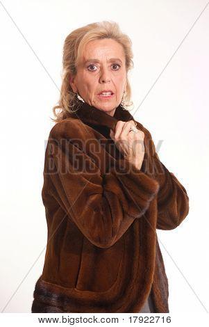 Portrait of an elegant senior lady in a mink coat