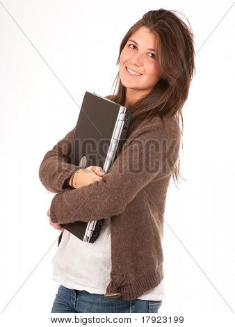 Isolated photo of a young pretty girl holding a laptop