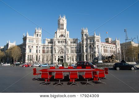 Meeting table and chairs in the middle of Plaza de la Cibeles in Madrid, Spain