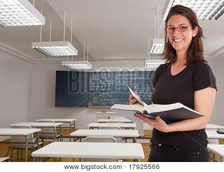 Cheerful female teacher in a maths classroom