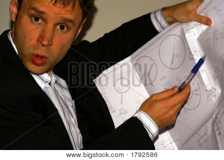 Angry Engineer With Drawing