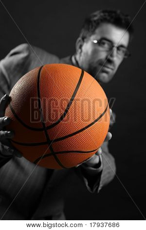 Businessman with basketball ball, teamwork, leadership metaphor