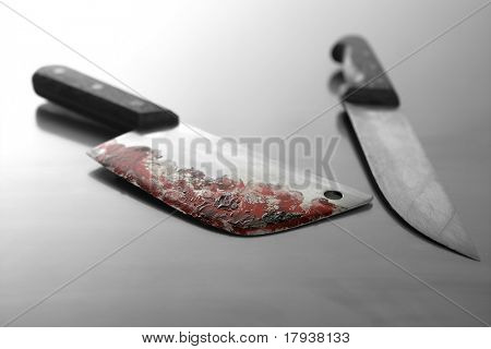 Bloody kitchen set of knifes, killer stuff over stainless steel table