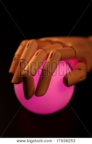 Wooden mannequin hand, ball of light, fortune teller