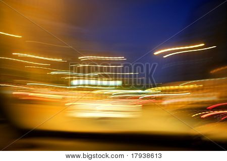 abstract blur city golden night lights, blue sky and traffic