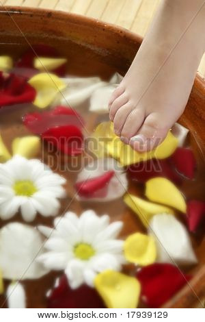 Aromatherapy, flowers children feet bath, colorful rose petal