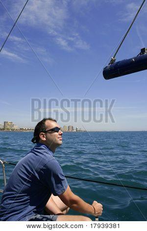 Sailor sailing blue tropical sea