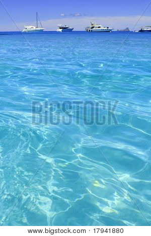 Illetes turquoise beach blue water Formentera boats horizon Illetas