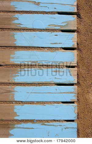 aged beach blue wooden floor over summer sand