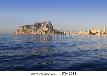 Ifach Penon mountain in Calpe from blue sea in Alicante province Spain
