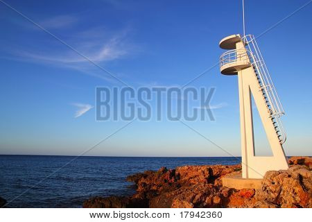 Baywatch white lookout tower in Mediterranean sea Denia Alicante Spain