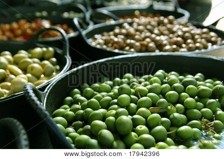 olives in pickling brine pattern background texture in market