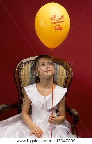 little girl with yellow balloon