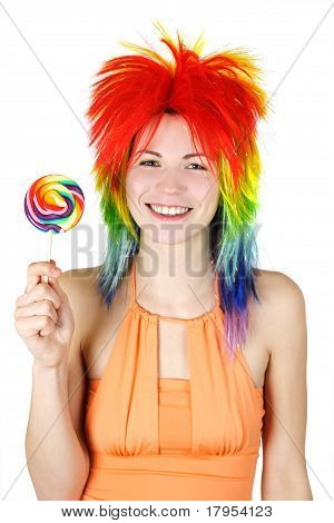 Young Beauty Woman In Multicolored Clown Wig Smiling And Holding Big Lollipop, Isolated