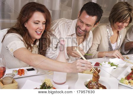 Group of attractive young professional people eating at upscale restaaurant