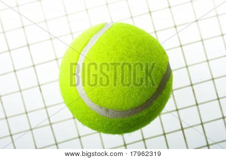 A Tennis Ball On Net Isolated On White Background.