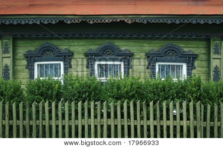 Windows Of A Old Russian House With Decorative Carvings