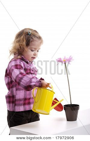Gardening: Little Girl Planting Pink Flower